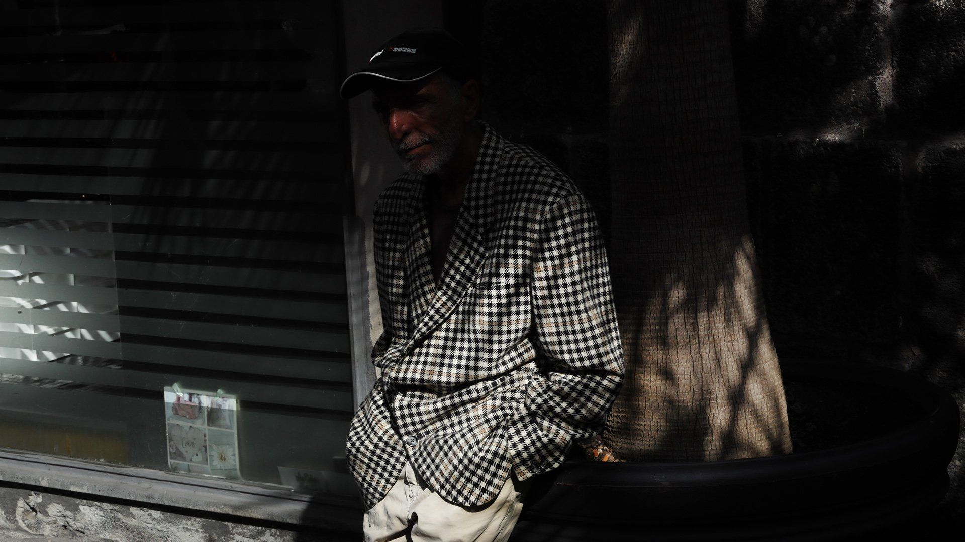 Subject candid on the streets of Italy wearing a blue chequered blazer.